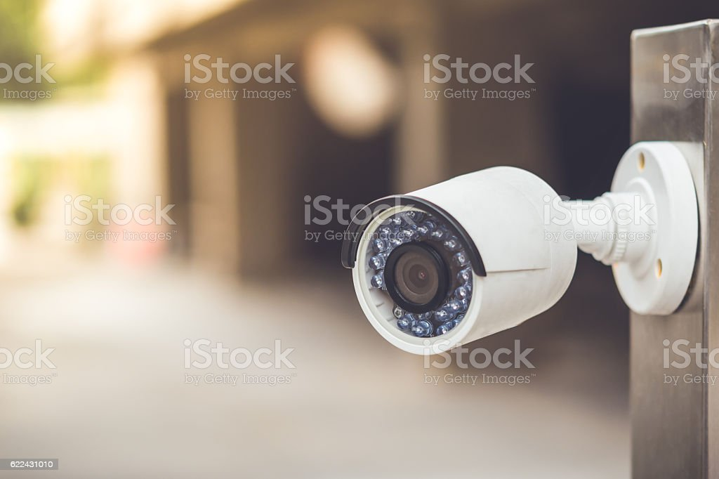 White cctv outside the building, security system​​​ foto