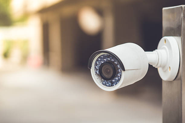 white cctv outside the building, security system - security system stock photos and pictures