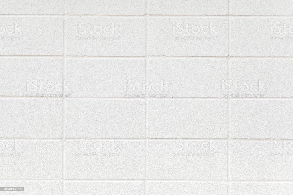 White cement block wall seamless background and texture stock photo