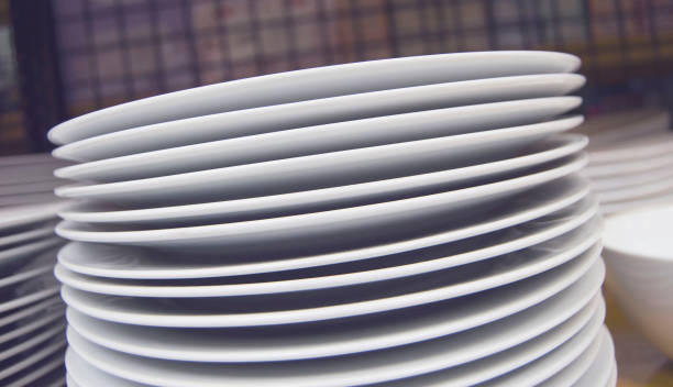 white ceramic dishes - commercial dishwasher stock photos and pictures