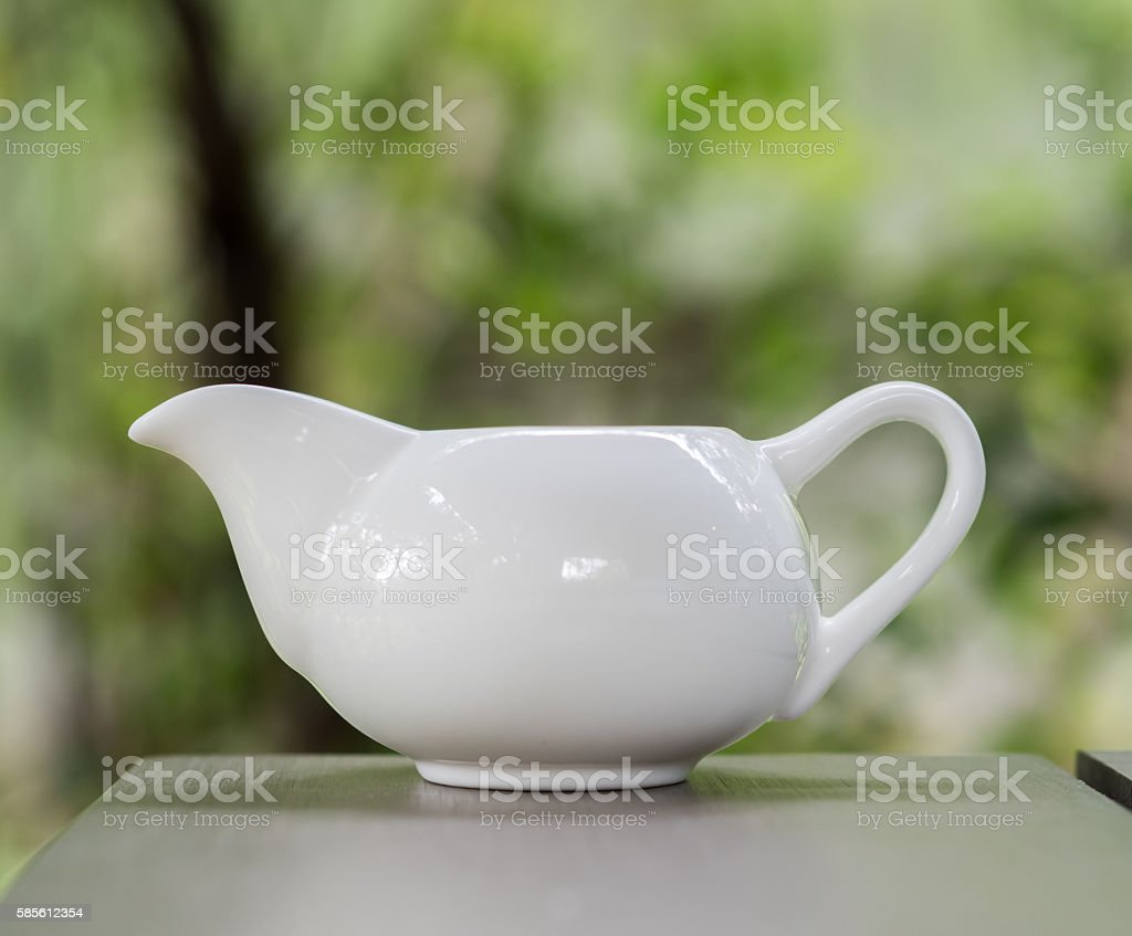 white ceramic milk jug, white ceramic jug, white ceramic pitcher stock photo