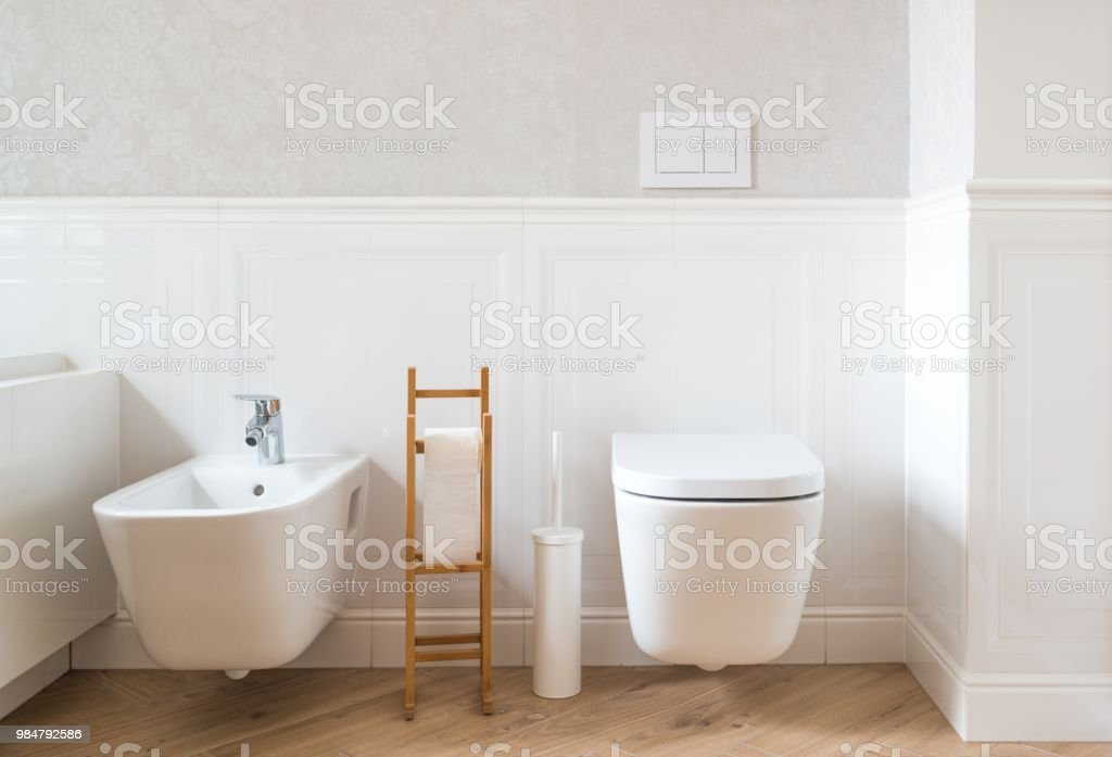 White ceramic toilet and bidet stock photo