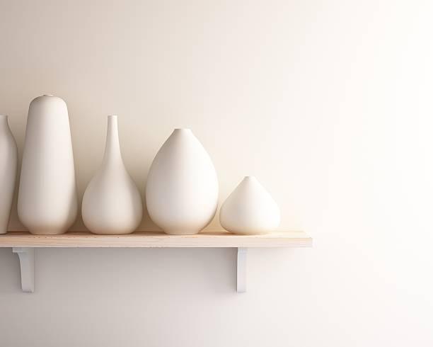 white ceramic vase on wood shelf stock photo