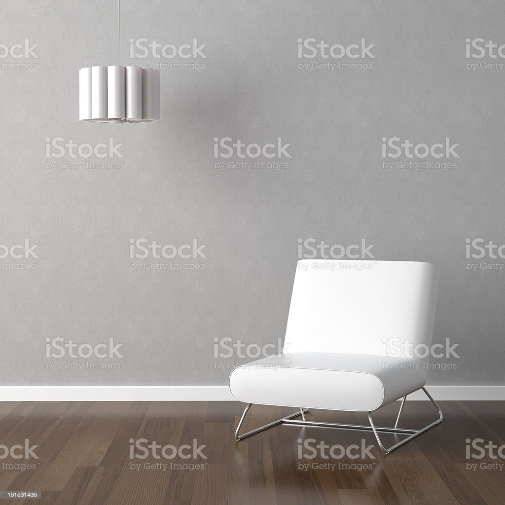 white chair and lamp on grey wall royalty-free stock photo