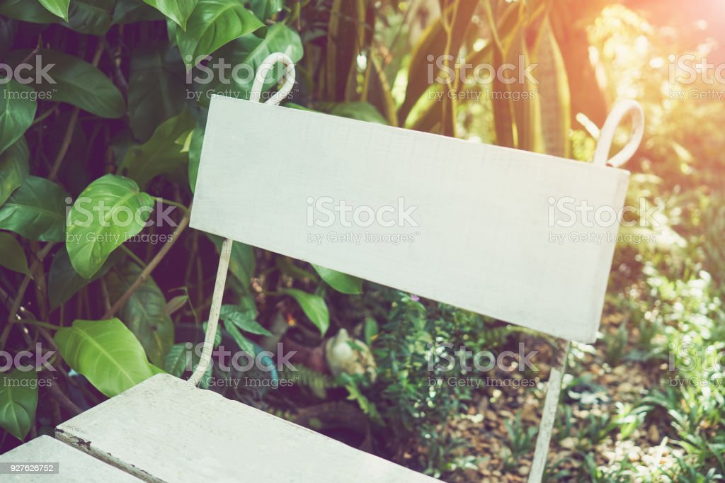 White chair backrest placed in the garden. stock photo