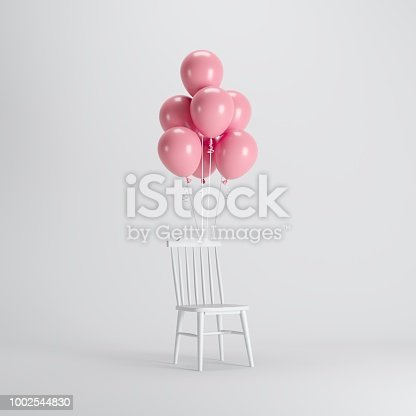 903520476 istock photo White chair with Pink balloons floating on white background. minimal party concept idea. 1002544830