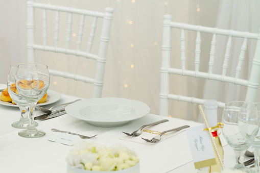 White Chairs And Fancy Table Set For A Wedding Dinner Stock Photo Download Image Now Istock