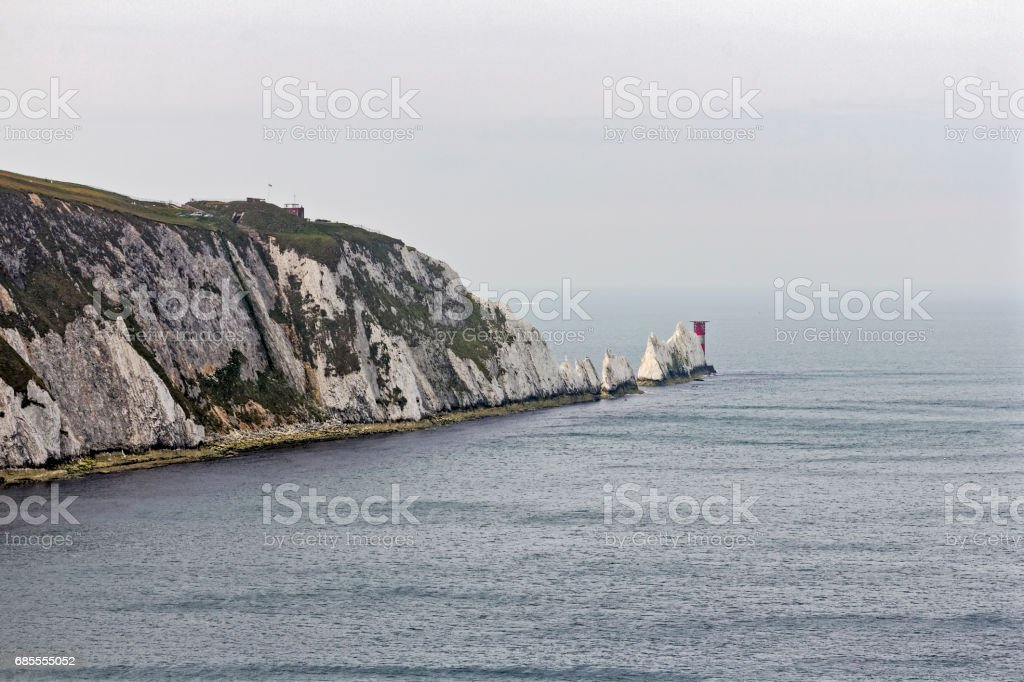 White chalk cliffs of Alum Bay, the Needles and Trinity Lighthouse stock photo