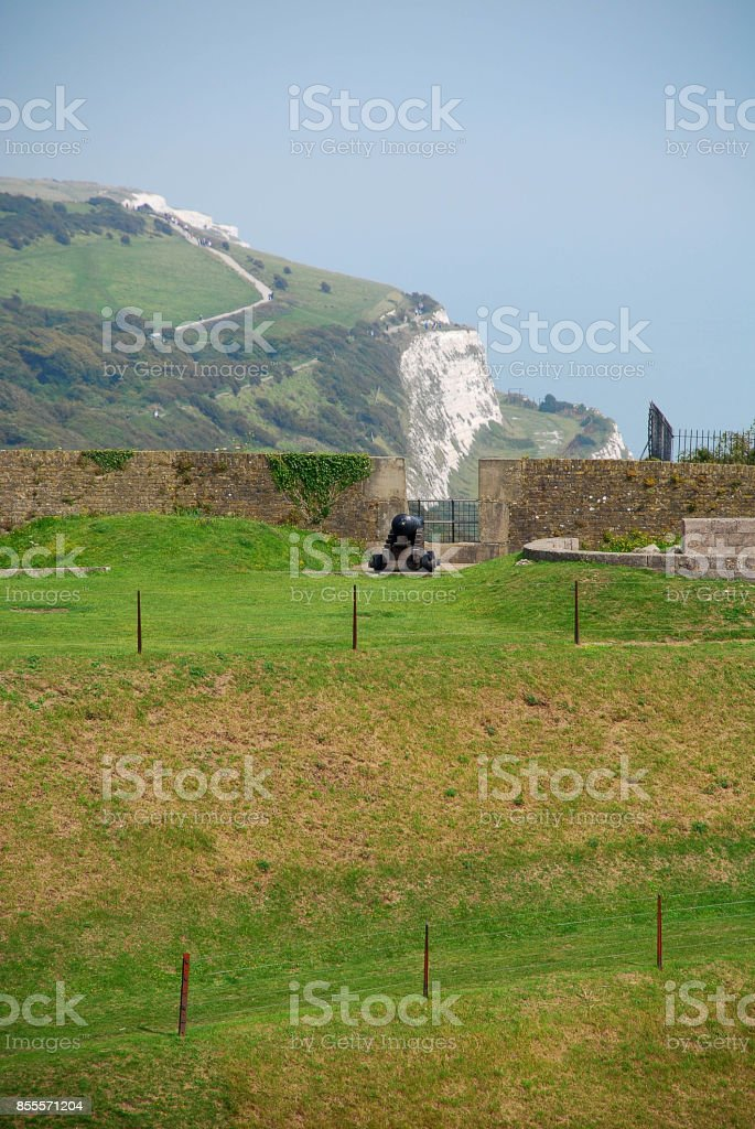 White chalk cliffs of Dover, in the front a cannon stock photo