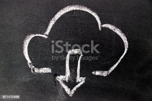istock White chalk drawing as cloud  and down arrow icon on black board background (Concept for cloud computer download) 821410498