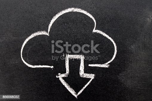 istock White chalk drawing in cloud with download arrow shape on black board background 856568032