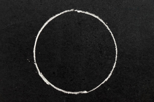 White chalk hand drawing as circle shape on black board background stock photo