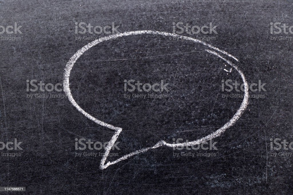 White chalk hand drawing in bubble speech shape with blank space for...