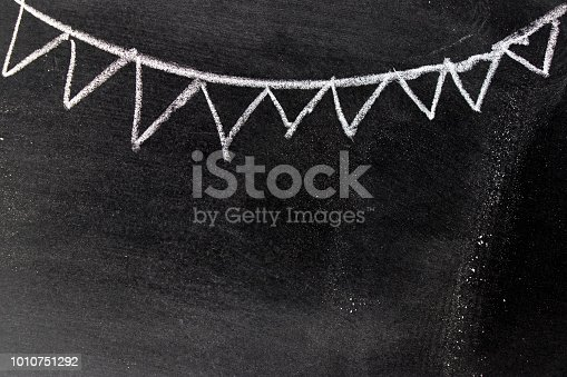 882318110 istock photo White chalk hand drawing in party flag shape on blackboard background with copy space for decoration or add text 1010751292