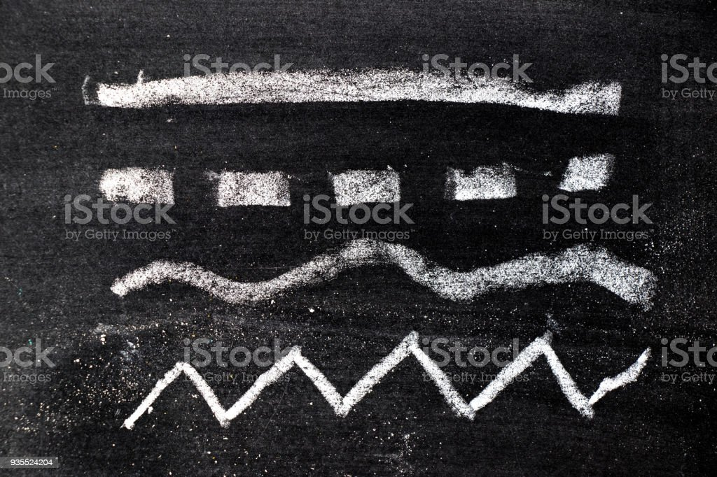 White chalk hand drawing in set of line shape on blackboard background stock photo