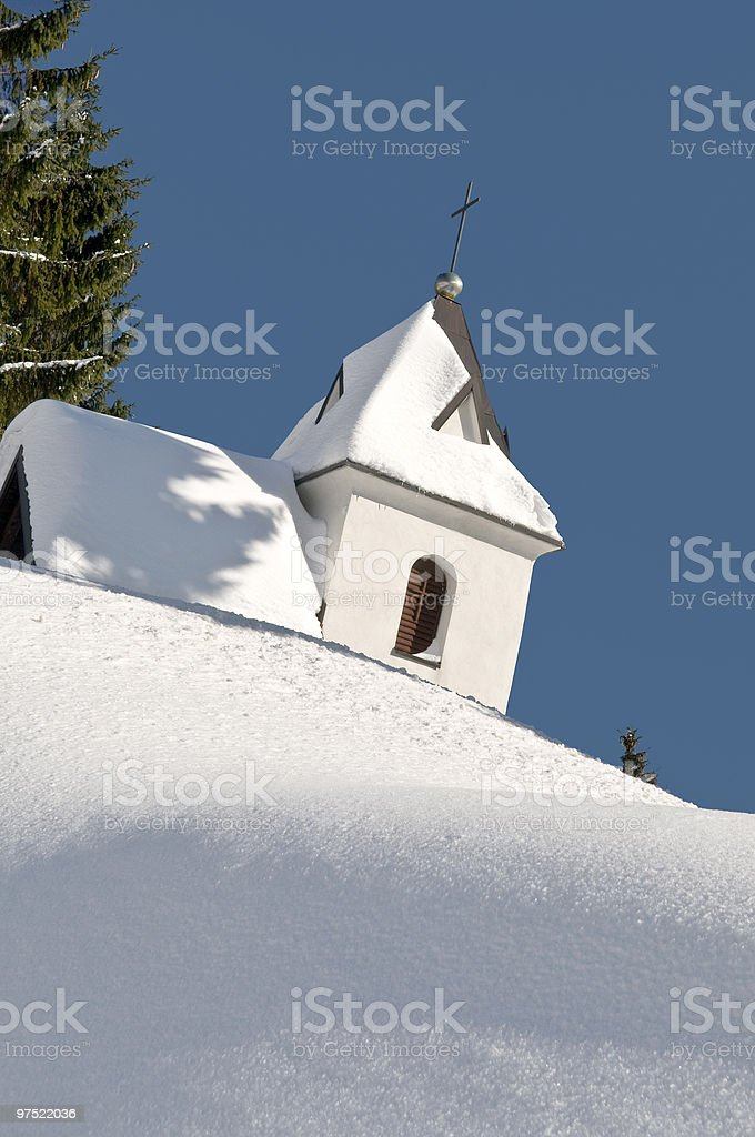 White Chapel Hiding on Snowy Pile royalty-free stock photo