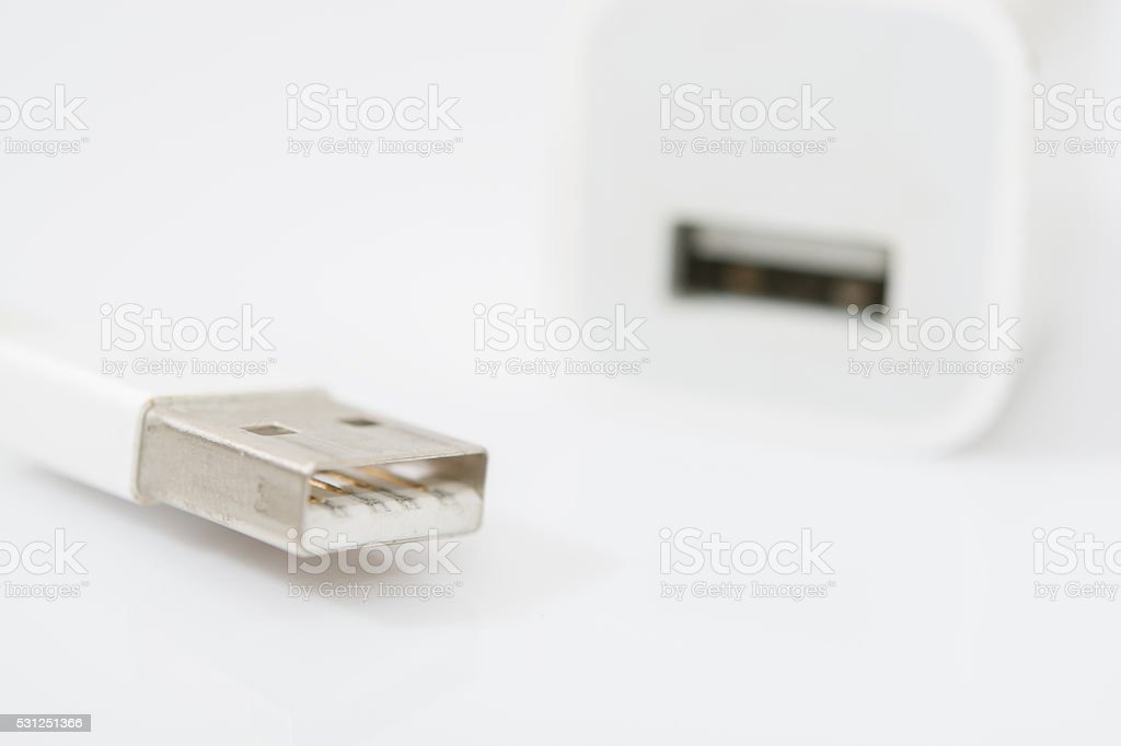 USB white charger adapter and USB cable on white background stock photo