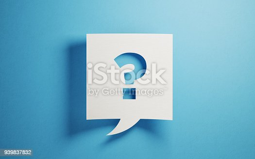 White chat bubble on  blue background. There is a question mark symbol  on chat bubble. Horizontal composition with copy space.