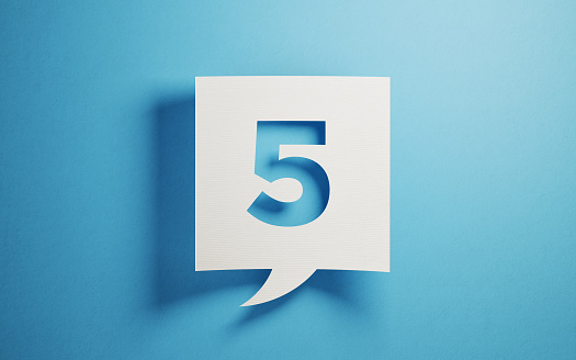 White chat bubble on  blue background. Number five writes on chat bubble. Horizontal composition with copy space.