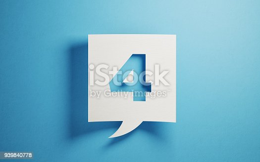 White chat bubble on  blue background. Number four writes on chat bubble. Horizontal composition with copy space.