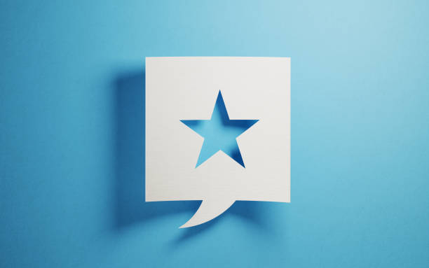 White Chat Bubble With A Cut Out Star Shape On Blue Background stock photo
