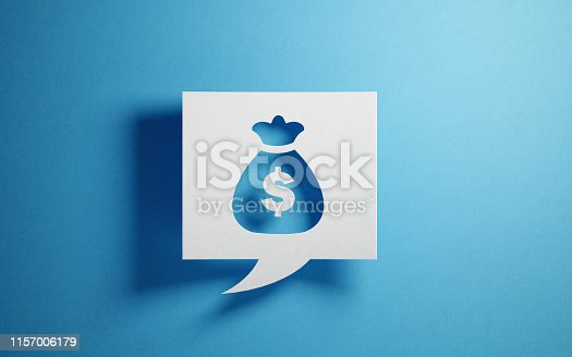 White chat bubble on  blue background. There is a money pouch symbol  on chat bubble. Horizontal composition with copy space. Financial planning concept.