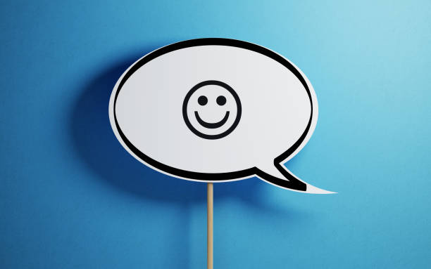 white chat bubble with a wooden stick on blue background - smiley face stock photos and pictures