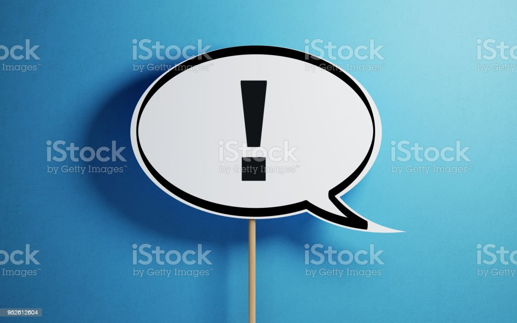 White Chat Bubble With A Wooden Stick On Blue Background stock photo