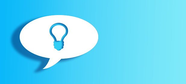 921154250 istock photo White Chat Bubble With Cut Out bulb Shape Over Blue Background 1145088070