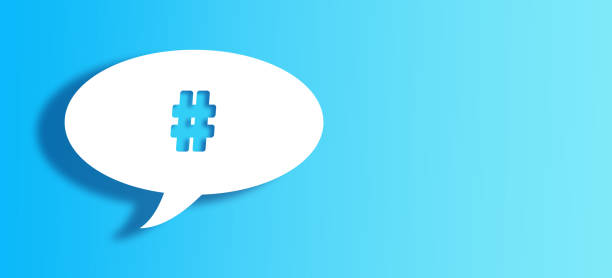 White Chat Bubble With Cut Out number or hashtag sign  Shape Over Blue Background stock photo