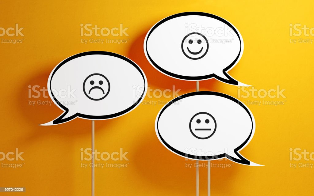 White Chat Bubble With Wooden Stick On Yellow Background stock photo