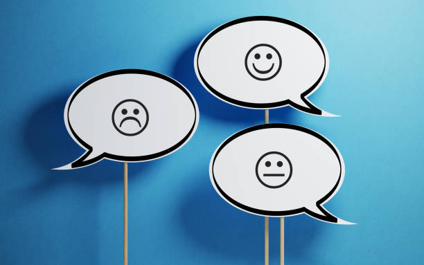 White Chat Bubble With Wooden Stick On Yellow Background White chat bubble with wooden stick on blue background. There are various smiley faces on the speech bubbles. Horizontal composition with copy space. questionnaire stock pictures, royalty-free photos & images