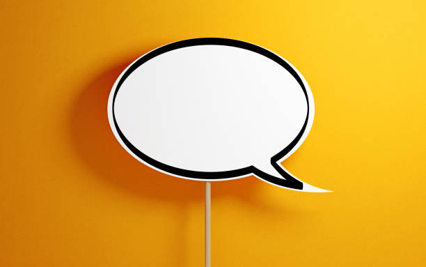 White Chat Bubble With Wooden Sticks On Yellow Background stock photo
