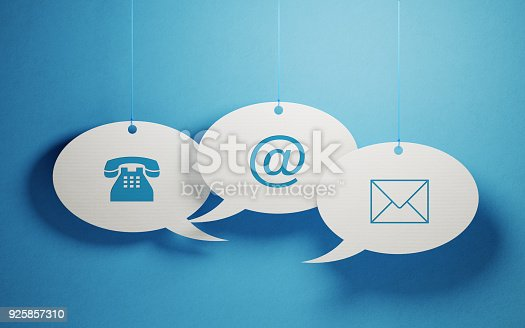 istock White Chat Bubbles Imprinted With Contact Us Symbols On Blue Background 925857310