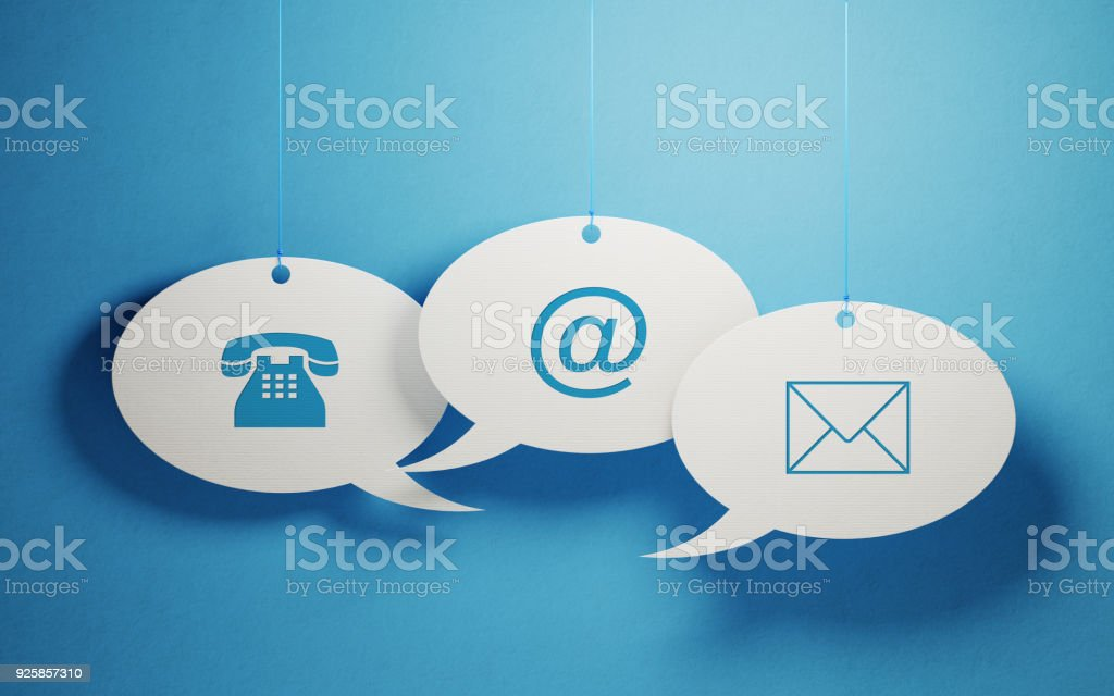 White Chat Bubbles Imprinted With Contact Us Symbols On Blue Background stock photo