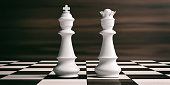 istock White chess king and queen on a chessboard. 3d illustration 1053768426