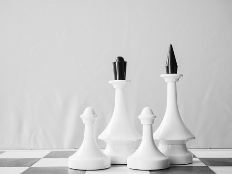 istock white chessman family concept - queen, king and two pawns 1129677208
