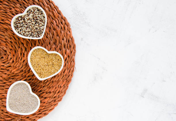 white chia, golden flaxseeds and quinoa mix - chia seed stock photos and pictures