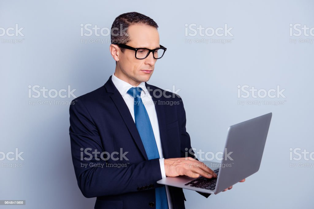 White chic classy shit groomed suit people official networking freelancer person concept. Half-turned portrait of focused smart pensive banker manager using netbook isolated on gray background royalty-free stock photo