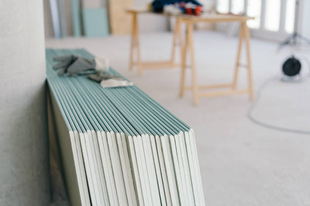 White chip board stacked inside a new build house stock photo