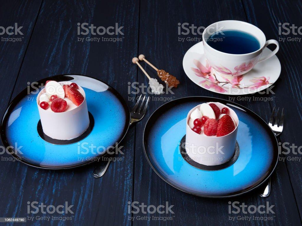 White chockolate cake with strawberies, raspberries and redcurrants stock photo