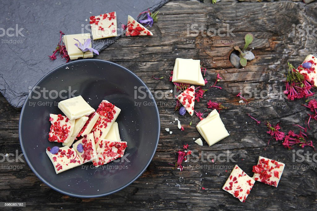 White chocolate in bowl with raspberries and lavender royalty-free stock photo