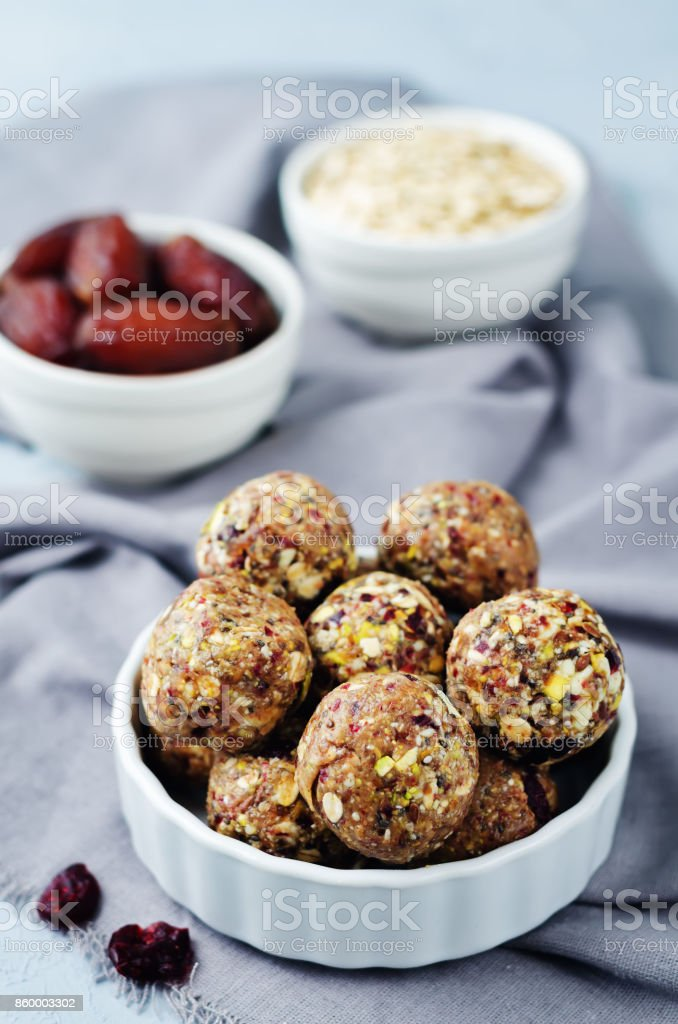 White chocolate pistachio dates oats flax seed raw balls stock photo