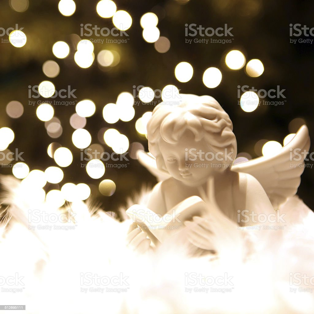white christmas angel and blur christmas lights royalty free stock photo