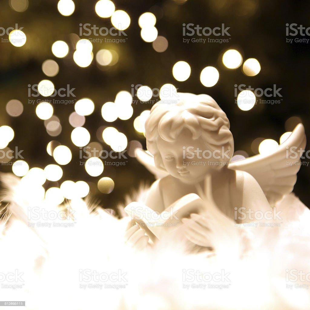 White Christmas Angel and Blur Christmas Lights stock photo