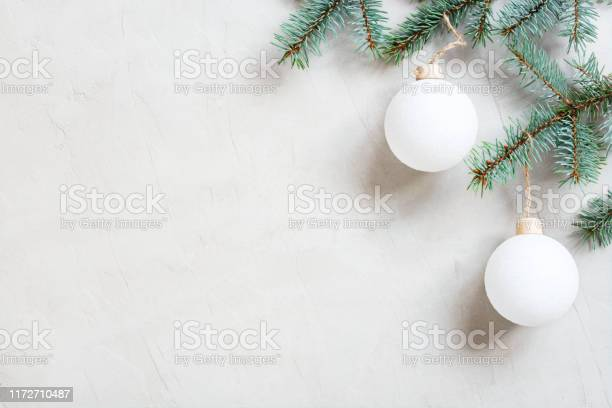 White christmas background with christmas tree branch picture id1172710487?b=1&k=6&m=1172710487&s=612x612&h=nwfjw1 bi29bsjqeusrc5zzqrkt9qcbp3un5by20mtm=