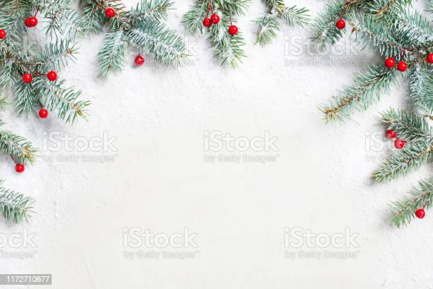 White christmas background with christmas tree branches and red picture id1172710677?b=1&k=6&m=1172710677&s=612x612&h=e sm8vkexo4iwwunuxqk3i dgcatavbo35t5mpg6ozg=