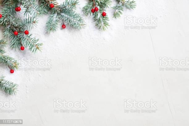 White christmas background with christmas tree branches and red picture id1172710678?b=1&k=6&m=1172710678&s=612x612&h=sqpbnqhl1vgetjzyppc8anrpx6 7d5yf 7e1c4pg7y0=