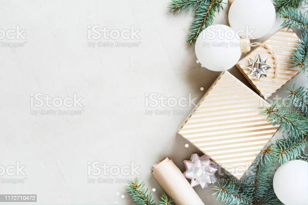 White christmas background with christmas tree branches gift box and picture id1172710472?b=1&k=6&m=1172710472&s=612x612&h=x5liryc3fysklbciyhfssvtieo g hffzbduc8r1myc=