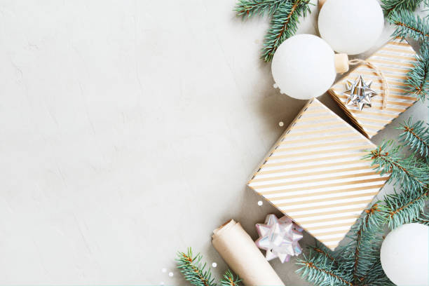 White christmas background with christmas tree branches gift box and picture id1172710472?b=1&k=6&m=1172710472&s=612x612&w=0&h=b61gdymaawts0y 7umhdw8ftwxlxweta4ibz qzigxq=